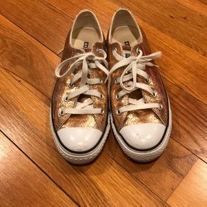 Converse crackled rose gold leather chuck taylors.